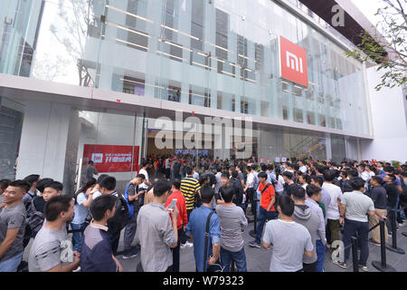 --FILE--Customers queue up in front of the world's first flagship Mi Home of Xiaomi during its opening ceremony in Shenzhen city, south China's Guangd - Stock Photo