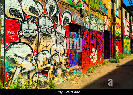Street art in Graffiti Alley, in the Fashion District of Toronto, Ontario Canada