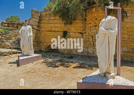 Headless Roman statues on display in archaeological site. Two torso marble statues exhibited at Valley of the Temples Park in Agrigento Sicily Italy. - Stock Photo