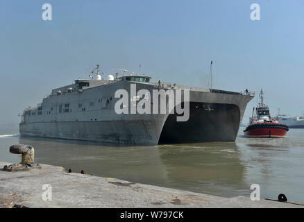 190804-N-UA460-0240 SURABAYA, Indonesia (Aug. 4, 2019) – The Spearhead-class expeditionary fast transport USNS Fall River (T-EPF 4) departs the Port of Tanjung Perak to participate in the sea phase of Cooperation Afloat Readiness and Training (CARAT) 2019. This year marks the 25th iteration of CARAT, a multinational exercise designed to enhance U.S. and partner navies' abilities to operate together in response to traditional and non-traditional maritime security challenges in the Indo-Pacific region. (U.S. Navy photo by Mass Communication Specialist 1st Class Greg Johnson) - Stock Photo