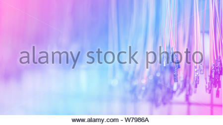 Bundle of crimped cables with electrical connectors. Terminated wire ready to creation connection. Abstract colorful industrial background with copy s - Stock Photo
