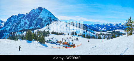 Winter is perfect season to visit Salzkammergut region and enjoy the sports activity in Dachstein West Alps, Zwieselalm mountain, Gosau, Austria - Stock Photo