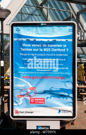 Sign in French, Dutch & German at Birchanger Services on M11 motorway warns foreign drivers to pay Dart Charge if they have crossed Thames at Dartford - Stock Photo