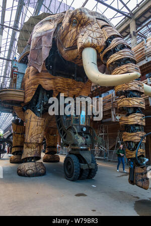 Nantes, France - May 12, 2019: The Great Elephant is part of the Machines of the Isle of Nantes carrying passengers in city square in Nantes, France - Stock Photo