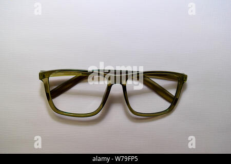 sunglasses isolated on desk table background - Stock Photo