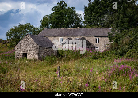 Abandoned Derelict Stone Building Cottage/House  and Outbuildings on the High Peak Trail  near Harboro Rocks,Brassington ,Peak District.Derbyshire.UK - Stock Photo