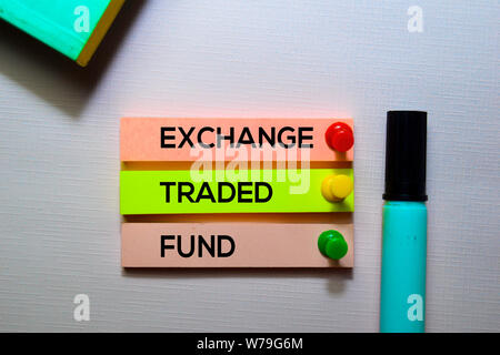 Exchange Traded Fund (ETF) text on sticky notes isolated on office desk - Stock Photo