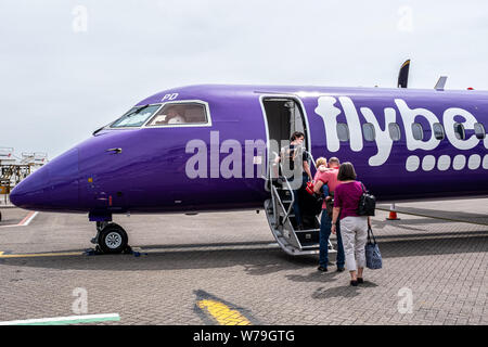 Passengers boarding a Flybe Bombardier Dash 8 turboprop at Southampton Airport, Hampshire, UK - Stock Photo