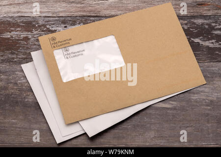 Folkestone, United Kingdom - July 26th, 2019 :  Brown HMRC envope.  An envelope from the UK tax office HM Revenue and Customs.    Never a welcome lett - Stock Photo