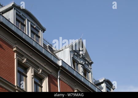 modern dormer on the rooftop of old building in Germany - Stock Photo