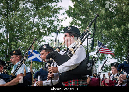 Fergus, Ontario, Canada - 08 11 2018: Pipers of the Pipes and Drums band paricipating in the Pipe Band contest held by Pipers and Pipe Band Society of - Stock Photo