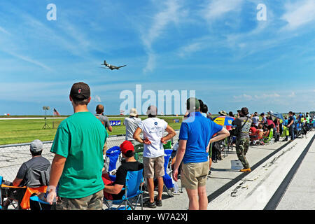 Spectators watch a performance at the 2108 Cleveland National Air Show at Burke Lakefront Airport in downtown Cleveland, Ohio, USA. - Stock Photo