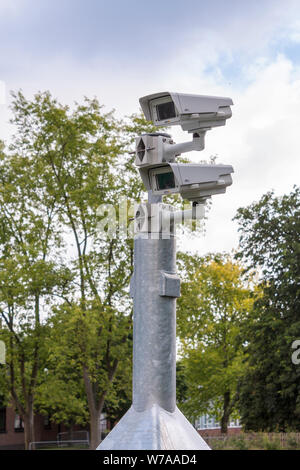 Multiple CCTV cameras mounted on post - Stock Photo