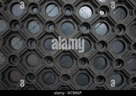 An elevated view of a black rubber doormat - Stock Photo