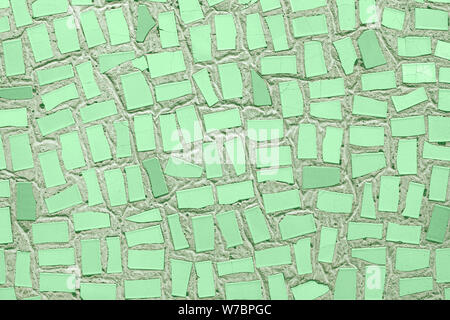 Closeup of trendy mint coloured abstract mosaic ceramic tiles patterned background. Year color concept. - Stock Photo
