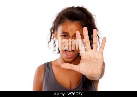 a scared african girl shows a stop hand - Stock Photo