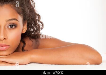 Half portrait of beautiful dark skinned woman on white background - Stock Photo