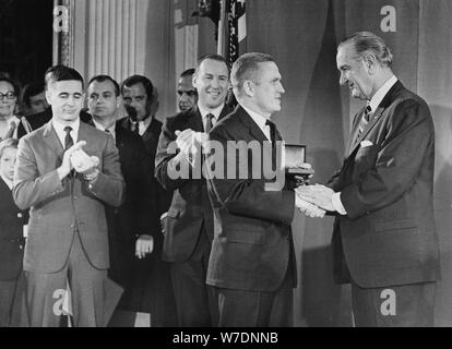 Apollo 8 astronauts receive distinguished service medals from President Johnson, January 1969. Artist: Unknown - Stock Photo