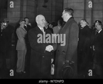 President Harry Truman greets French PM Rene Pleven, Washington Station, January 1951. Artist: Unknown - Stock Photo