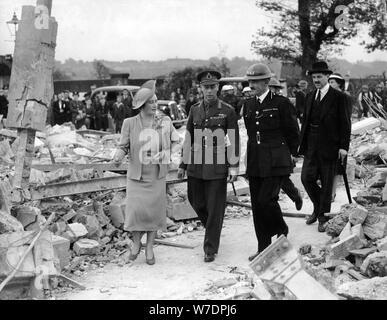 Queen Elizabeth and King George VI inspecting air raid damage, World War II, 1940-1945. Artist: Unknown