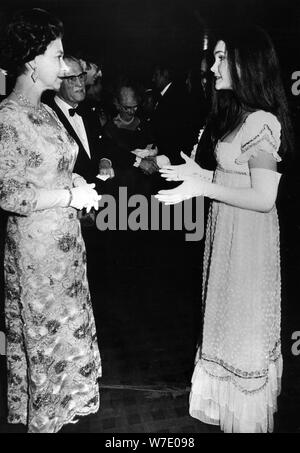 Fiona Fullerton meets the Queen at the premiere of 'Alice's Adventures in Wonderland', 1972. Artist: Unknown - Stock Photo