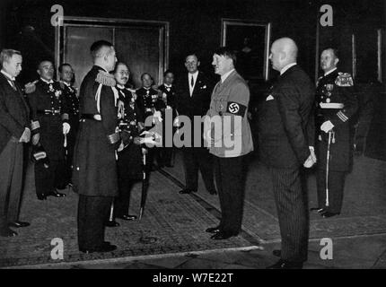 Adolf Hitler meeting a Japanese naval delegation, 1934. Artist: Unknown - Stock Photo