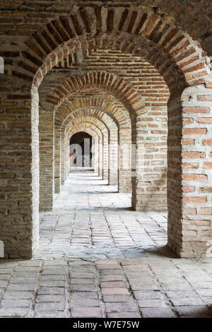 Arcade at Karavansaray building in Sheki, Azerbaijan. The building dates from the 18th century. - Stock Photo