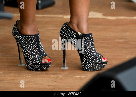 A woman wearing high-heeled shoes - Stock Photo