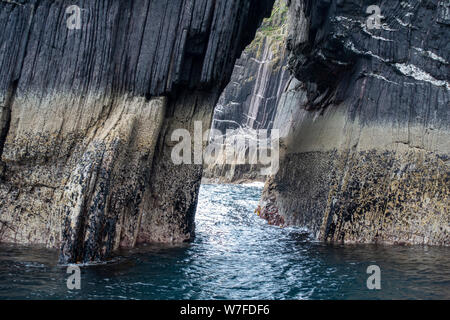 Sea arch viewed from boat - Dingle Peninsula, County Kerry, Republic of Ireland