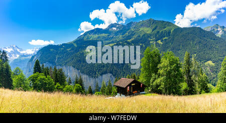 Lonely house in Swiss Alps, Switzerland - Stock Photo