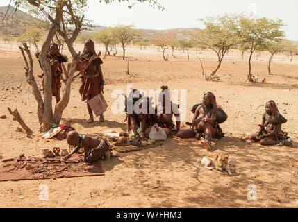 Himba tribe village, Kaokoveld, Namibia, Africa - Stock Photo