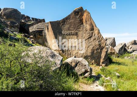 Gobustan, Azerbaijan - May 1, 2019. Stone marking entrance to Gobustan national park in Azerbaijan. - Stock Photo