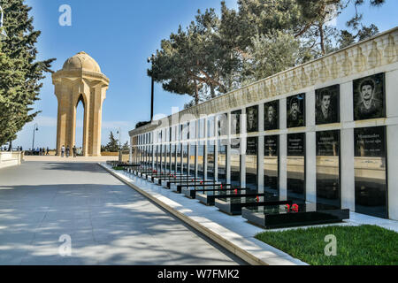 Baku, Azerbaijan - May 2, 2019. View of the Alley of Martyrs, towards the Eternal Flame Memorial, in Baku. View with graves and people. The Alley of M - Stock Photo