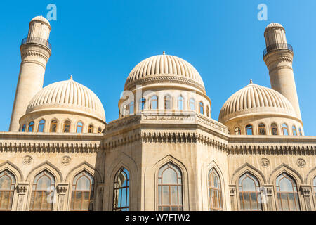 Bibi-Heybat, Baku, Azerbaijan - May 11, 2019.  Minarets and domes of the Bibi-Heybat mosque in Baku. The existing structure, built in the 1990s, is a - Stock Photo