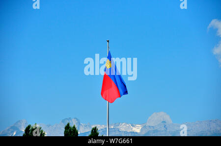 24 July 2019, Liechtenstein, Vaduz: The national flag of Liechtenstein - The Principality of Liechtenstein is 300 years old. It was founded on 15 August 1719, between Switzerland and Austria. Capital is Vaduz (in the picture). Photo: Volkmar Heinz/dpa-Zentralbild/ZB - Stock Photo