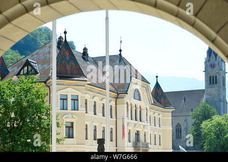 24 July 2019, Liechtenstein, Vaduz: The Principality of Liechtenstein is 300 years old. It was founded on 15 August 1719, between Switzerland and Austria. Capital is Vaduz (in the picture the government building and the cathedral). Photo: Volkmar Heinz/dpa-Zentralbild/ZB - Stock Photo