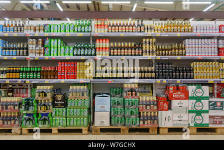 Moscow, Russia, February 11 2019: Beer bottles on shelf in supermarket with colorful labels. Suitable for presenting new beer bottles and new designs - Stock Photo