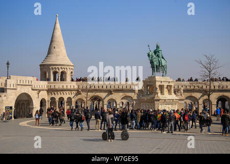 Budapest, Hungary, March 22 2018: Fisherman Bastion and statue of Stephen I. - Stock Photo