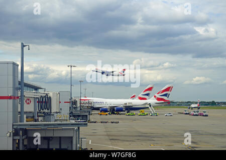 HEATHROW, ENGLAND -28 JUL 2019- View of an airplane from British Airways (BA) taking off at London Heathrow Airport (LHR), the main airport in London. - Stock Photo