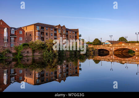 Northampton UK. 23nd July 2019. A warm sunny morning along a quite stretch of the River Nene close to the Town Centre, with reflections in the calm wa