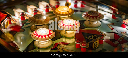 Budapest, Hungary - March 25, 2018: Pinball game museum. Pinball machine table close up view of retro vintage game arcade. Details of a Bright and Col - Stock Photo