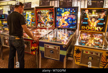Budapest, Hungary - March 25, 2018: Pinball museum. Pinball table close up view of vintage machine. - Stock Photo