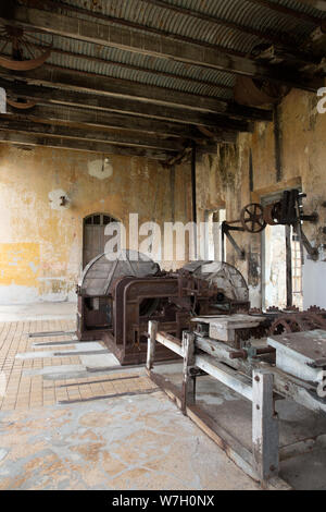 A well-preserved and large machine house, or casa de maquina, where the henequen shredding machines (planta desfibradora) were used to render fibers from the henequen plant at Hacienda Yaxcopoil in the Uman Municipality, state of Yucatan, Mexico on July 22, 2019. Hacienda Yaxcopoil dates back to the 17th century and was once considered one of the most important rural estates in the Yucatan, spreading across 22,000 acres. It operated first as a cattle ranch and later as a henequen plantation during the golden age of the 'agave sisal'. Over time, due to continuous political, social and economic - Stock Photo