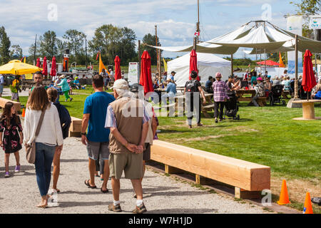 People and families attending the 2019 Richmong Maritime Festival along the Steveston waterfront in British Columbia - Stock Photo