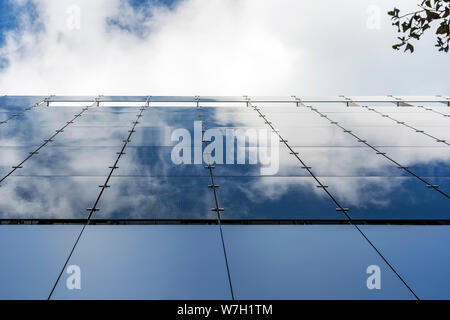 Glass And Aluminum And Blue Sky And Modern Architecture. Clouds Are Reflecting In The Glazing Facade And Aluminium Panels. - Stock Photo