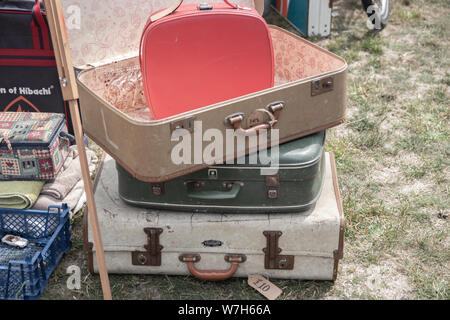Vintage suitcases stacked on top of each other for sale - Stock Photo