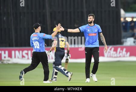 Hove Sussex UK 6th August 2019 -  Reece Topley (right) of Sussex Sharks celebrates bowling Marchant de Lange during the Vitality T20 Blast cricket match between Sussex Sharks and Glamorgan at the 1st Central County ground in Hove Credit : Simon Dack / Alamy Live News - Stock Photo
