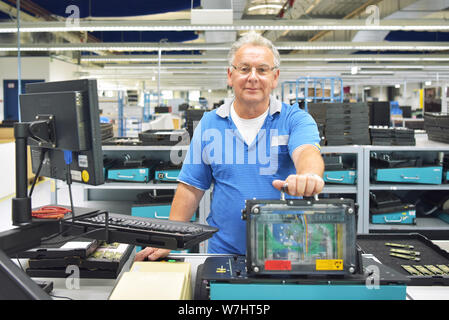 production of electronic components in a modern factory - engineer at the workplace - Stock Photo