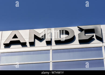 July 30, 2019 Santa Clara / CA / USA - AMD logo displayed on the facade of their offices located in Silicon Valley, south San Francisco bay area - Stock Photo