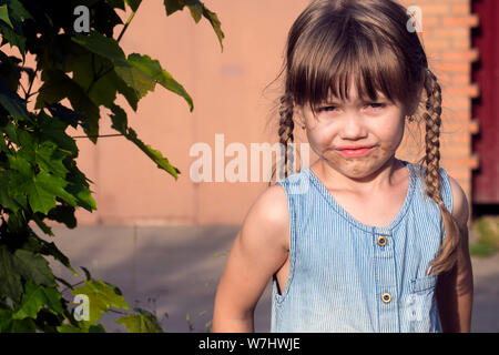 Little Muddy girl. Little naughty girl face smeared in chocolate - Stock Photo